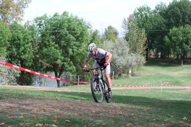 Darren attacks the exit climb out of the Front section after lap1 flat on his CX bike