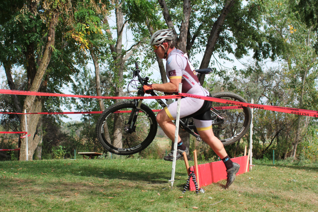 Darren clears the barriers with comparatively heavy mountain bike