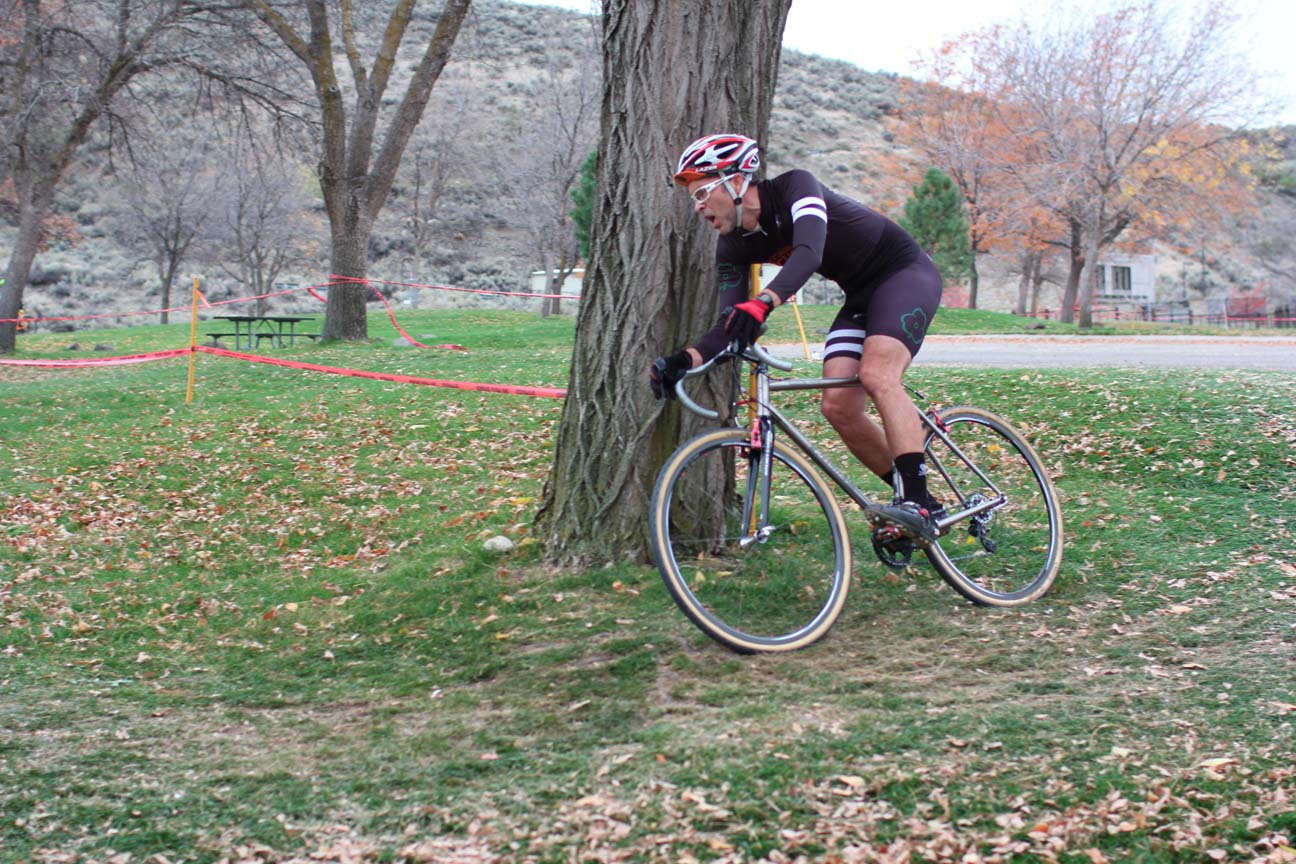 Tim Kelley takes an off-camber tree-root turn