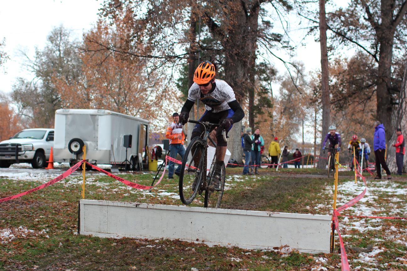 Damien hops the barriers at Lakeview Park pleasing the crowd in the center of the course