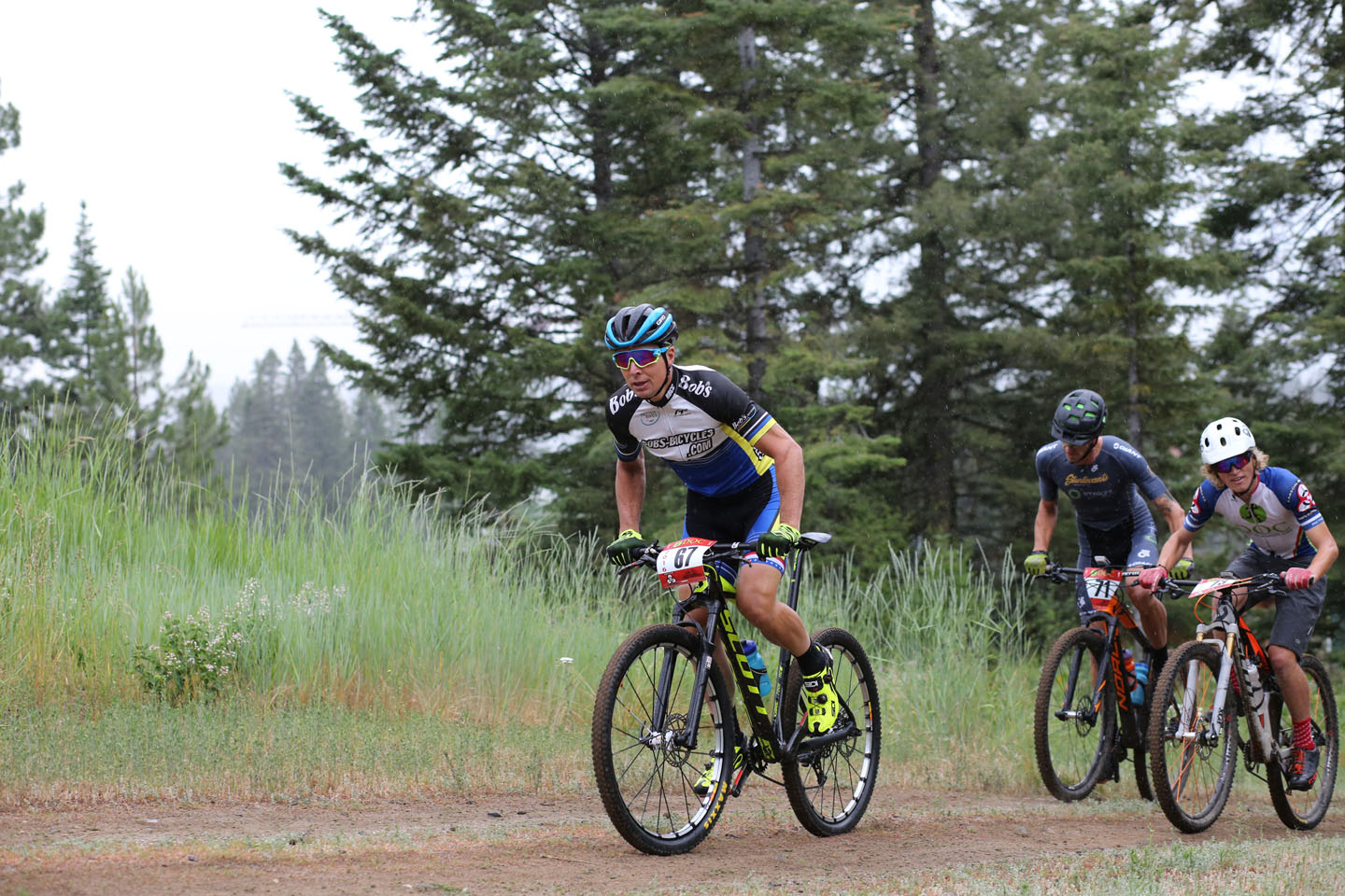 """Jamey Yanik leads Ian Mullens and Eric Chizum up the first """"Bunny Hill"""" climb, and takes first place after leading the whole race"""